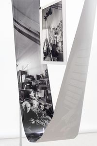 Photographing Robert Doisneau installation showing prints 1 & 2:  side view