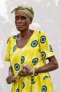 A. Doreen: Works in quarry breaking stones to create gravel. Earns 1,000 shillings ($0.32) per Jerrycan of gravel. Earns 10,000 to 15,000 shillings per day.