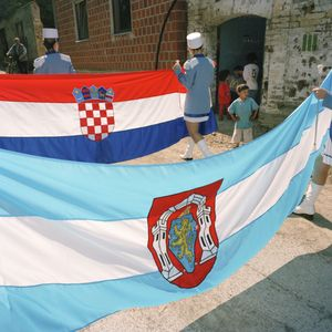 Majorettes carry the flags of Croatia and Vukovar through the town centre during a procession. © Colin Dutton