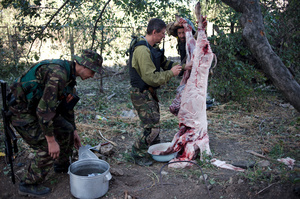 "Ukrainian military surrounded and cut off from all of the food and ammunition supply. During the last days it was difficult to find even a packed lunch and drinking water. The guys from the battalion ""Donbass"" fresh carcass of a ram caught in the street. August 27, 2014. Ilovaysk."