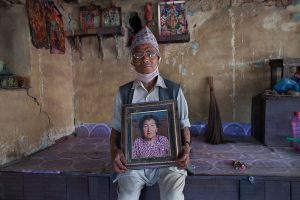 Geyan Madhu(75), holds a photograph of his wife, who was killed in the earthquake in Bhaktapur, Nepal.