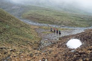 Women walk back to camp together as the weather deteriorates. Upper Dolpo, Nepal, June 2017.