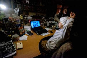 The owner of Bhaktivedanta Library Services watches the festival kirtans by livestream in her office