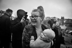 Mother and child in tears.