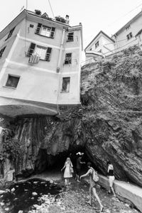 House on cliffs edge in Vernazza, Italy