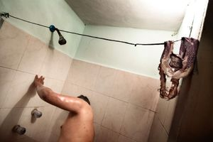 Reyna Patricia in the shower before his working hours. © Meeri Koutaniemi