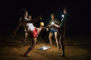 Men playing Chinlone, Myanmar's national sport on a field in Pa Dan Kho Village.