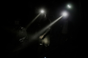 Miners walking in a tunnel to reach the deepest worksite.