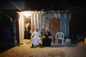 At a shack, Salman Saliman Abu Mutlag, 80, and his wife Marym Hmdan, 67, their grand daughter Hchhtam, 24, and 1 year and half old grand-grand son Qosay pose. They still have to live at their destroyed home compound in Khan Yunis due to Israeli artilleries and bulldozers during the summer's 50-day war between Israel and Hamas. They cannot leave, since there is no place else for them to move.
