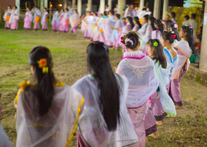 Girl dance under the moonlight on the village green for their Lai Haraoba.