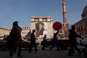 A banner depicting Afghan President Hamid Karzai hangs in Kabul, Afghanistan on January 4, 2010. © Adam Ferguson