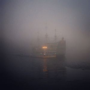 A boat moves in heavy fog in Hakone, Japan.