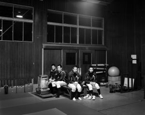 """Baseball players of Soma Noko high school practice inside the gymnasium in Minamisoma. After the decontamination of their baseball field, they started practicing outside, though the radiation level was still relatively higher than the so called """"Normal Level"""". From the series """"Fragments/Fukushima"""" © Kosuke Okahara"""