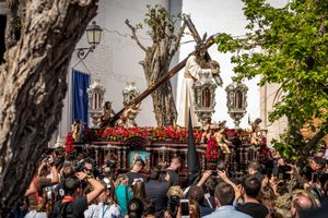 Large crowds gather to see the impressive pasos pass through the small streets of Granada, Spain.