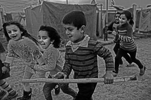 Children inside the camp have very good life. They went to school everyday. There was primary school for children inside the Domiz Refugee camp. In the afternoon they play on the lane of their tents. © Khaled Hasan