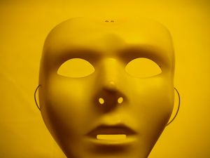 Yellow mask and yellow plastic tablecloth