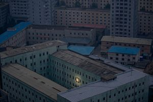 1st prize Daily Life Singles: © Damir Sagolj, Bosnia and Herzegovina, Reuters Pyongyang, North Korea, 5 October.  A picture of North Korea's founder, Kim Il-sung, decorates a building in the capital Pyongyang.