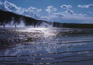 Yellowstone geyser basin with people on Boardwalk