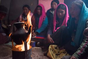 People from Karang rest in a tent after a day's work. Upper Dolpo, Nepal, June 2017.