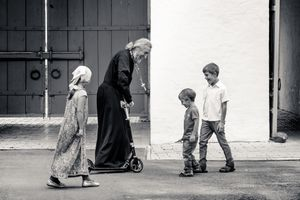 Priest and children