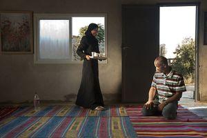 "Iman Serving Her Father From the series ""Eighteen"" © Natan Dvir"