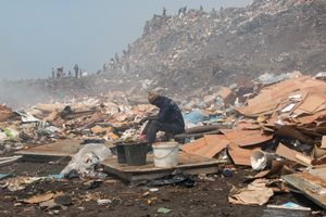 Workers search through mountains of waste while smoke makes it difficult to see and to breathe. Garbage has been accumulated in Mbeubeuss since the 1960s.