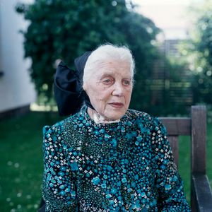 Maria Mirtschink (b. 1916)  in her  Sunday dress, Catholic Lusatia, Germany 2010. From the series: Village Queens. The last women in their traditional peasant garbs