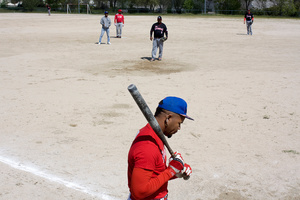 "A team player ""Dream Team"" prepares to bat."