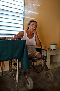 Yoandra , Gherson s wife, also HIV positive
