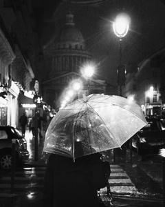 On the road, Paris behind the umbrella