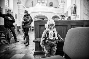 At the church, the youngest visitor.