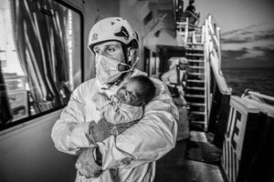 MOAS search and rescue team with rescued new born baby
