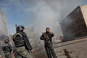 An Afghan Commando attempts to control a scene at Pashtunistan Square after insurgents attacked with two suicide bombers and the rest fought to the death with Afghan Security Forces near the Presidential Palace in Kabul, Afghanistan on January 18, 2010. © Adam Ferguson