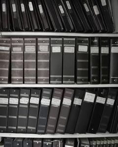 Shelves of photo albums from the 1940s through today. She used to say that if there were a fire in her home, she would grab her photo albums first. But now she worries there are too many. I told her to grab the oldest ones.