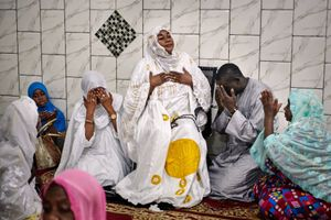 Zeyda Moussoukoro Mbaye, 58, prays together with her disciples on November 28, 2018 at the Mosque of Cheikh Islam Baye Niasse in Castor, a quarter of the Senegalese capital Dakar. She is a Muqaddam, as the spiritual leaders of the Sufi brotherhood of the Tijianiyya are called, but she is also a successful entrepreneur with 58 employees  and a member of the Chamber of Commerce of Kaolak.