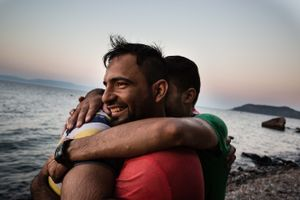 September 2015, Lebsos, Greece. On the beach of Skyminea arrives  a small plastic boat packed with refugees from Turquie.