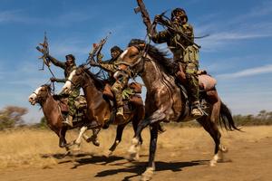 Rangers exhibit their riding skills as they return to Zakouma National Park after weeks on elephant patrol. Zakouma, Chad, 07 January 2015.