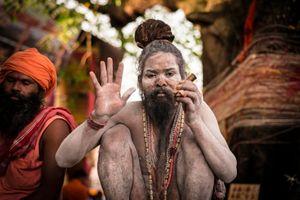 Shaivas Sadhu with chilam giving Darshan or blessing,  Kumbh Mela, India,  2015.