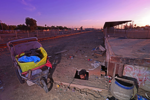 Farmworker living in a hole in the ground