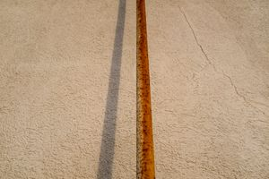 Rusty Pipe and Stucco