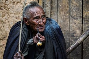 A Man with Smoking Pipe