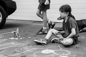 Hunter and Amalia drawing on the driveway, Greystone Farm Guanaba QLD Australia 2015.