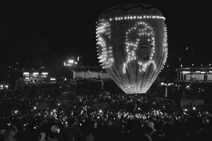 A hot air balloon sporting the image of Buddha drawn with individual candles about to be launched