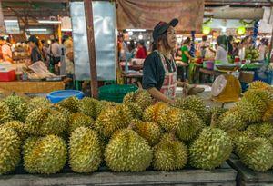 Durian vendor on the Kamala Beach market, Thailand.