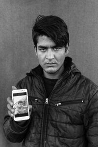 Naingal (18) holds a photo of his dead cousin Rahmajan Hanifi (18) who tried to cross the Serbian-Hungarian border on February 2nd over a frozen river, together with 15 other refugees. As the ice broke the refugee fell in the water. He was being watched dying, as he could not swim, by Hungarian border security guards who did not help.His body was found 2 days later in Hungary.