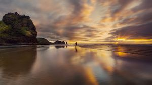 Solitary moment at Piha Beach, New Zealand at the Golden Hour
