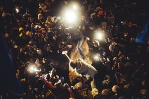 Anti-government protesters beat the statue of Vladimir Lenin with a sledgehammers in KIev, Ukraine, December 8, 2013.