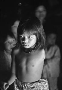 Photograph by Philip Jones Griffiths. Quynh Lan, 11 years old, at her home in A Luoi, Vietnam. Her father was sprayed many times with Agent Orange. © Philip Jones Griffiths / Magnum Photos