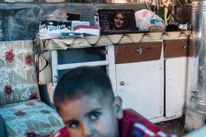 22/01/2015 -- Kirkuk, Iraq -- A young Iraqi boy, inside a tea shop in the IDP camp of Laylan, south of Kirkuk.