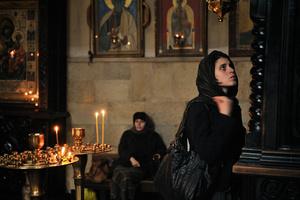 A girl prays in a church in Tbilisi.